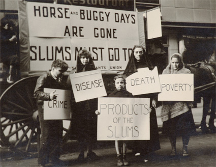 Slums Must Go! May Day Parade, New York by Joe Schwartz. Source: thejewishmuseum.org