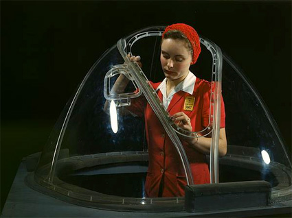 This girl in a glass house is putting finishing touches on the bombardier nose section of a B-17F navy bomber... by Alfred T. Palmer. Source: loc.gov