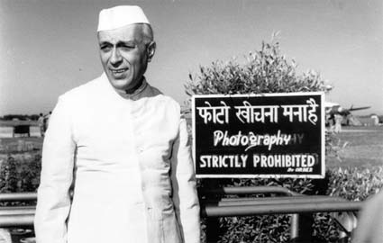 Jawaharlal Nehru caught by the camera at Palam airport... by Homai Vyarawalla. Source: rmanyc.org